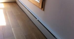 Le radiateur plinthe : avantages, prix, installation